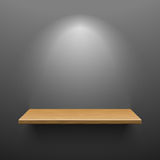 Wooden shelf on dark wall Stock Images