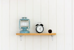 Wooden shelf with decoration objects. Background Royalty Free Stock Images