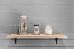 Wooden shelf with decoration ornament on vintage plank wallpaper Royalty Free Stock Photo