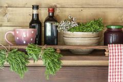 Wooden shelf with dishes and spices close-up stock photography
