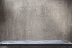 Wooden shelf and grey wall. Background texture stock photography