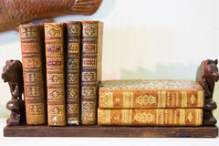 Wooden shelf with old books. Small wooden shelf with some old books Stock Photos