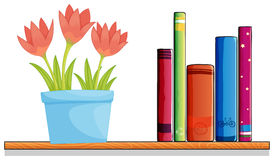 A wooden shelf with a pot of flower and books Royalty Free Stock Photos