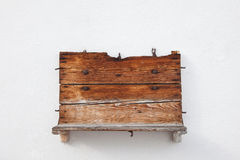 Wooden shelf. A wooden shalf at the wall Stock Images