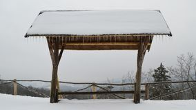Wooden shelter with distance view in winter stock photos