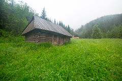 Wooden shelter in the forest of Tatra mountains Stock Photos