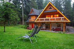 Wooden shelter in the forest of Tatra mountains Stock Image