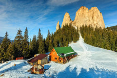 Wooden shelter in mountains,Carpathians,Transylvania,Romania,Europe. Winter landscape and wooden hut in the mountains,Lonely Rock,Transylvania,Carpathians Royalty Free Stock Photo