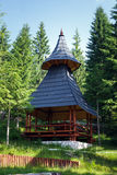 Wooden shelter near a pine forest Stock Image