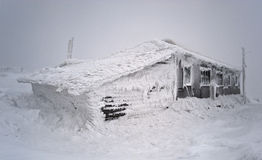Wooden shelter in a snowstorm. Urals, Russia Stock Photos