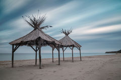 Wooden shelters on the beach Royalty Free Stock Photography