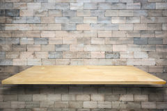Wooden shelves and cement wall background. Royalty Free Stock Photo