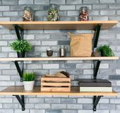 Wooden shelves with different home related objects. Stock Photos