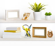 Wooden shelves with different office related objects.  Stock Image