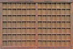 Wooden shelves. Grunge old wooden brown empty shelves rack Royalty Free Stock Image