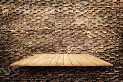 Wooden shelves on modern stone texture wall texture background Stock Photography