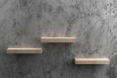 Wooden shelves on raw Cement wall. In loft Style wall for background Royalty Free Stock Photography