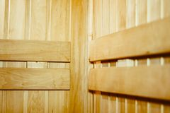 Wooden shelves in the sauna. The interior of the sauna - shelves, window, lamp, nobody Stock Photo