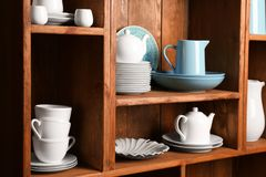 Wooden shelves with white and blue   dinnerware. Wooden shelves with white and blue rustic dinnerware Stock Photo