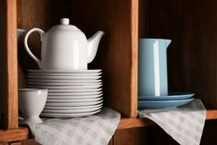 Wooden shelves with white and blue rustic. Dinnerware Royalty Free Stock Images