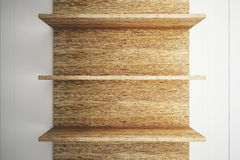 Wooden shelves on wood wall Stock Photography