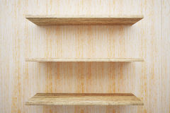 Wooden shelves on wood wall Royalty Free Stock Photo