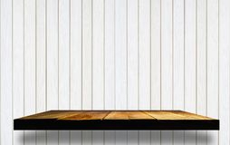 Empty wooden shelves on wooden wall Stock Image