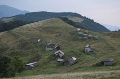 Wooden shepherds` houses in the Ukrainian Carpathians. stock images