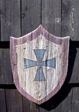 Wooden shield and a cross Stock Photo