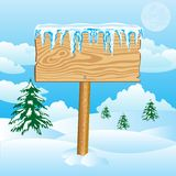 Wooden shield on snow Stock Image