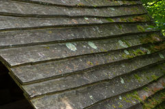 Wooden shingle on the roof of a house. A wooden shingle on the roof of a house Royalty Free Stock Photo
