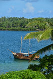 Wooden ship docked off Trou d`Eau Douce, Mauritius Royalty Free Stock Photo