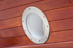 Wooden Ship porthole. View from outside Stock Photos