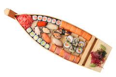 Wooden ship with rolls and sushi Royalty Free Stock Image