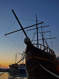 Wooden ship in sunset. The old traditional Croatian wooden boat moored in the harbor at sunset in Adriatic sea (Croatia - Dalmatia - Mediterranean) . At the stock photo