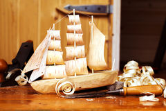 Wooden ship toy workshop carpenter with a plane Royalty Free Stock Photography