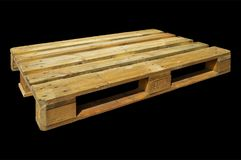 Wooden shipping pallet. Isolated on a black background Royalty Free Stock Photo