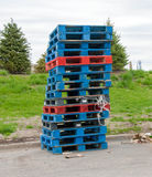 Wooden shipping pallets. Stack of wooden shipping pallets at warehouse ready for cargo Stock Image