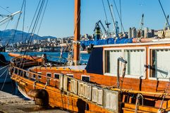 Wooden Ships and cranes in port of Rijeka. View on city port in Rijeka and some ship and cranes on goods terminal Royalty Free Stock Photos