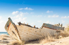 Wooden shipwreck on a beach in Malia, Crete. Wooden shipwreck on a beach in Malia, island of Crete Royalty Free Stock Photos