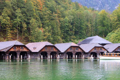 Wooden shipyard in the lake. A row of shipyard in the water of lake Stock Photos