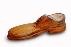 Wooden shoe. Brown wooden shoes on a white background Royalty Free Stock Photography