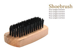 Wooden shoe brush and black bristles with sample text Royalty Free Stock Images