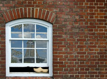 Wooden shoe in window Stock Photography
