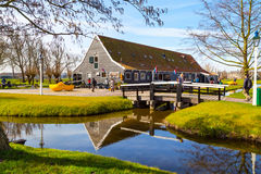 Wooden shoes, clogs or klompens museum, Zaanse Schans village, Holland, tourists around Stock Photo