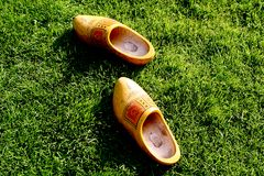 Wooden shoes in the grass. Wooden shoes are left upon a lawn Stock Photo