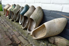 Wooden shoes. Many wooden shoes against wall Stock Images