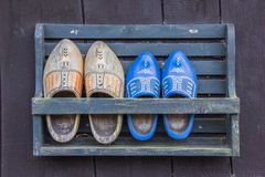 Wooden shoes in a rack Royalty Free Stock Photography