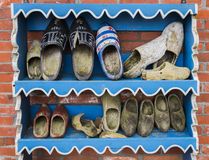 Wooden Shoes on Rack Royalty Free Stock Image