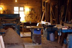 Wooden shop with sawdust. A small shop for the production of wood products Stock Images